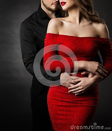 Couple Fashion Beauty, Woman in Red Dress and Embracing Man in Love