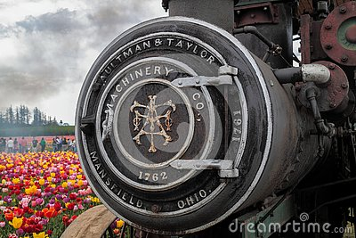 Up close view of a front part of a steam engine with engraving on it