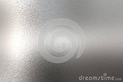 Light shining on rough chrome metal wall texture, abstract background