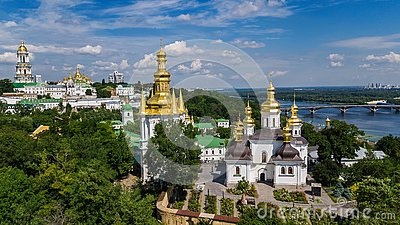 Aerial drone view of Kiev Pechersk Lavra churches on hills from above, cityscape of Kyiv city, Ukraine