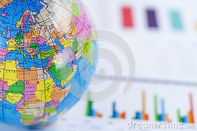 Chart graph paper with globe world Europe map on . Finance, Account, Statistics, Investment, Analytic research data economy.
