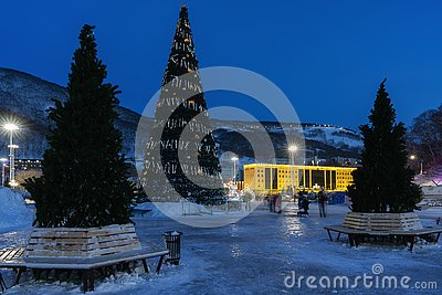 Night view of Christmas tree in snowy town Happy New Year
