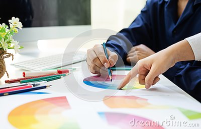stock image of graphic designer asian working together color swatches ux design editor ideas concept