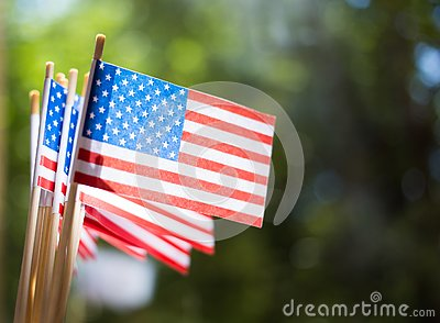 Miniature paper flags USA. American Flag on rustic wooden background