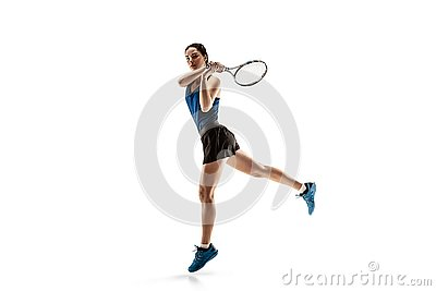 Full length portrait of young woman playing tennis isolated on white background