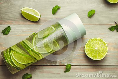 Health care, fitness, healthy nutrition diet concept. Fresh cool lemon mint infused water, cocktail, detox drink, lemonade in a
