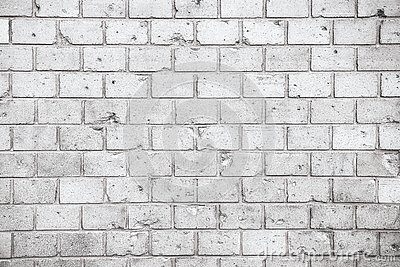 Simple grungy grey white brick wall with light and dark gray shades seamless pattern surface texture background. Wall weathered.