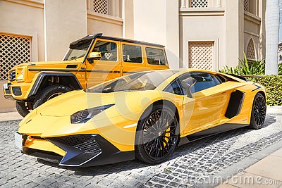 DUBAI, UAE - JANUARY 08, 2019: yellow luxury supercar Lamborghini Aventador Roadster and Gelandewagen in Dubai