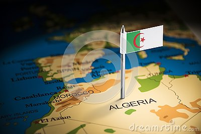 Algeria marked with a flag on the map