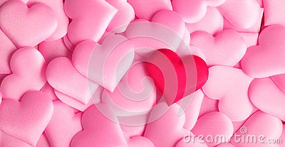 Valentine`s Day. Holiday abstract pink Valentine background with satin hearts. Love concept