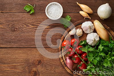 Menu, recipe, mock up, banner. Food seasoning background. Spices, Herbs and round wooden cutting board on brown dark wooden