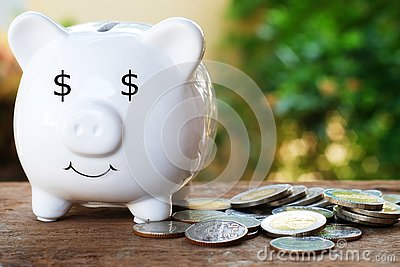 Piggy bank with dollar eye and pile of coin for saving money concept