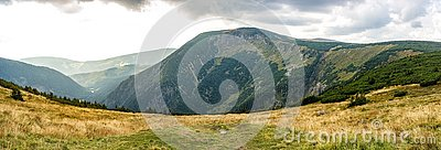 Mountain panorama in the cloudy day. Beautiful natural panoramic landscape in the summer time. Beautiful panorama for a postcard