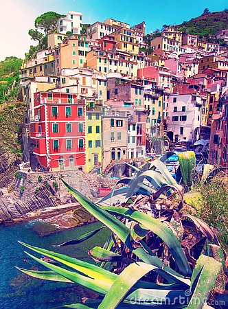 Charming fascinating city landscape with rocks on the coast of Riomaggiore in Cinque Terre, Liguria, Italy. beautiful places