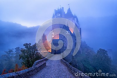 The medieval gothic Burg Eltz castle in the morning mist, Germany