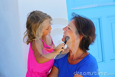 Turists in Santorini are happy to wear makeup during their holidays in Greece