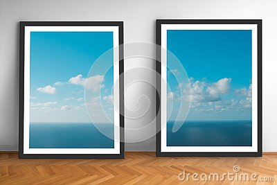 Framed picture prints of ocean and blue sky landscape photography on wooden floor
