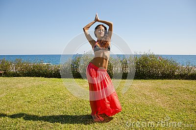 Feeling flirty. Sensual girl on sea beach. Eastern beauty. woman with fit belly. Spa and relax. Perfect body of belly dancer