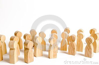 A crowd of wooden figures of people on a white background. Social survey and public opinion, the electorate. Population