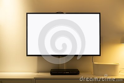 stock image of living room led blank screen tv on concrete wall with wooden table and media player. mockup blank screen tv for copy space