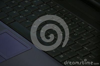A Laptop Computer Keyboard is Shown Up Close in a Diagonal View