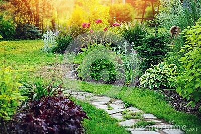 beautiful summer cottage garden view with stone pathway
