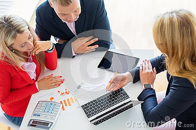 Man and woman getting help from professional financial consultant