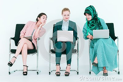 Business woman with bad manners sneaky copying from co worker to steal idea of teammate