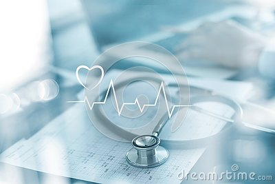 Stethoscope with heart beat report and doctor analyzing checkup on laptop in health medical laboratory