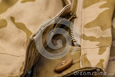 Close up of zipper and button camo pants