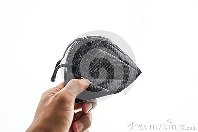 stock image of black mask for prevent air pollution on a white background. always wear a mask when feeling impure air