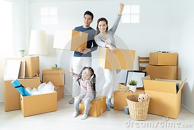Happy young Asian family moves the boxes to a new home. Moving Concept