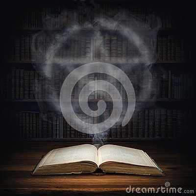 The old mysterious book and the smoke coming out of it is a sign of the pentagram. Occult, esoteric, divination, magic concept