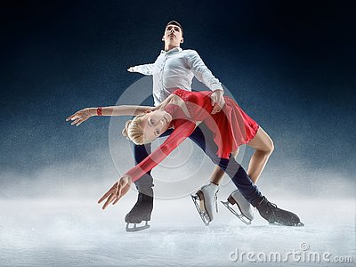 Professional man and woman figure skaters performing on ice show
