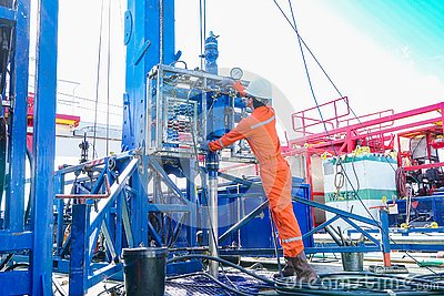 Offshore oil rig worker inspect and setting up top side tools for safety first in hazardous area to perforation crude and gases