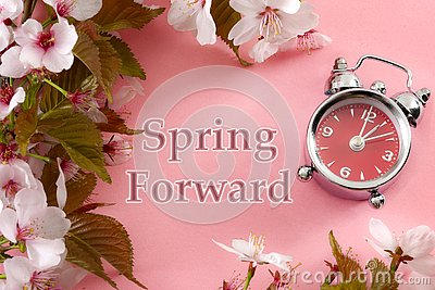 Turn clocks on hour ahead, star of daylight savings time change and reminder to spring forward concept with alarm clock on pink