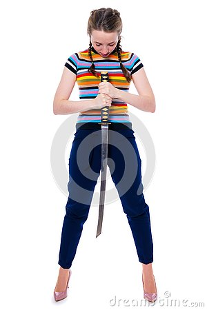 Samurai girl holding a katana in her hands bowed her head in deference. Isolation on a white