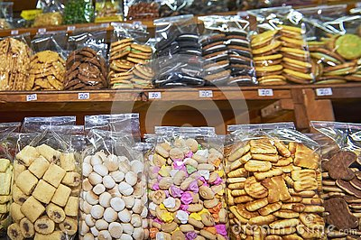 stock image of cookies packed in clear plastic bags standing on a shelve at a stall in thailand