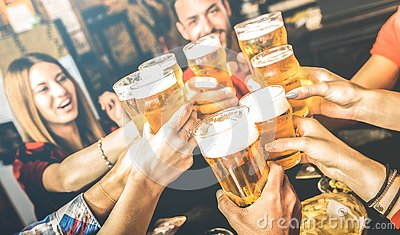 Friends drinking beer at brewery bar restaurant on weekend - Friendship concept with young people having fun together