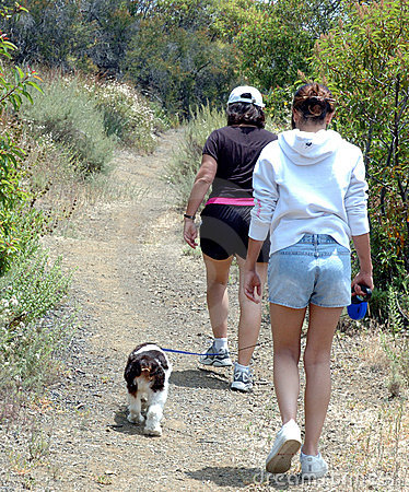 Two women and dog hiking,