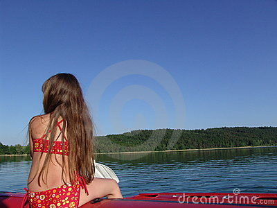 Girl sits on the boat