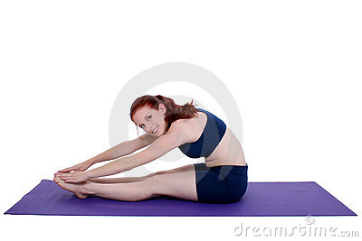 Beautiful Teenage Girl Demonstrating Yoga Stretch