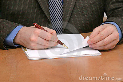 Business man writing on blank paper