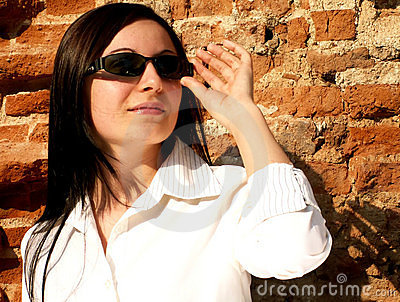 Woman with sunglasses looking to the future