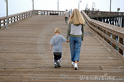 Mother and son on pier