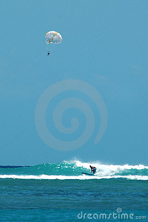 Parasailing and surfing