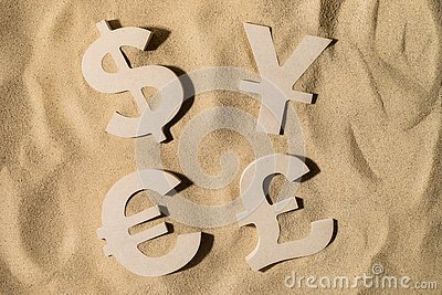 stock image of world wealth on the sand