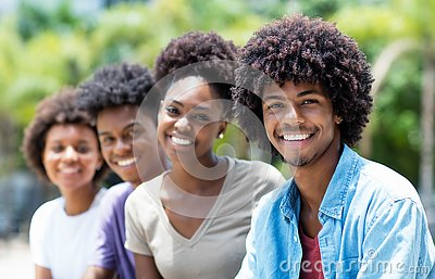 Handsome african american man with group of young adults in line
