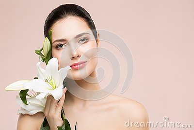 Woman Beauty Natural Makeup Portrait with Lily Flower, Happy Girl Face Skin Care and Treatment