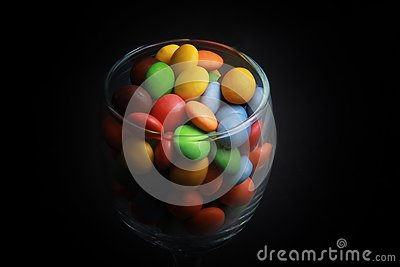 stock image of colorful candies in a glass.